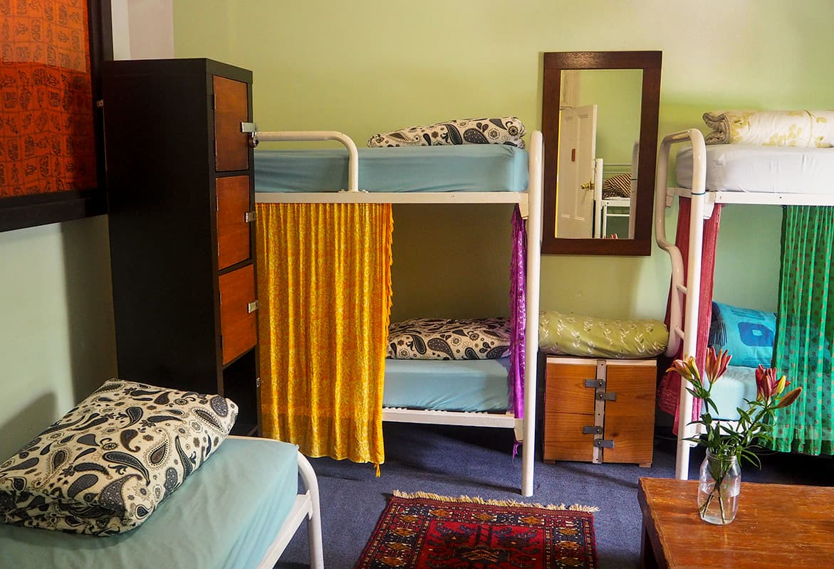 8 bed dorm rooms with lockers and linen provided