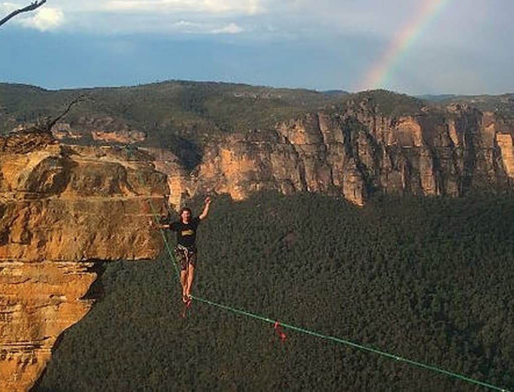 slack lining blue mountains